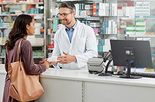 A pharmacist dispensing drugs in a pharmacy